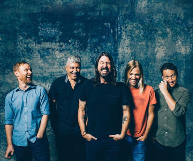 Imagen promocional de Foo Fighters, risueños cual Allman Brothers Band.