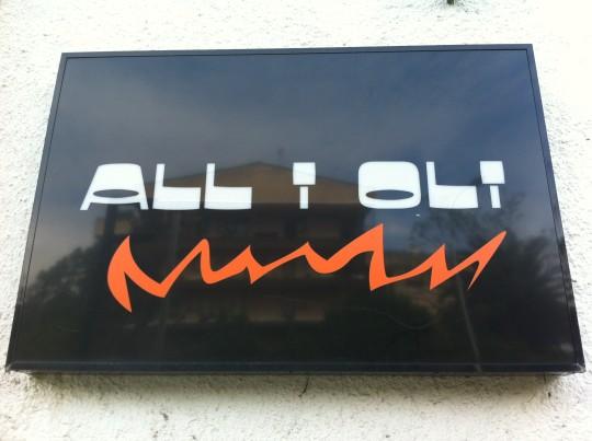 Letrero del restaurante All i Oli (foto: Cuchillo)